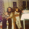 1976 - a Winter Sunday afternoon -- Dad with baby Ashley & Amelia