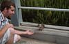 Bryan feeding a friendly squirrel in La Jolla