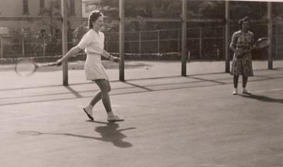 1947 Julie and Eileen playing tennis on tennin opening day NET