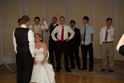 The bachelor boys wait to catch the garter.  Notice Jeff trying to reduce his chance ot catching as much as he can.