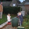 Sophie and Caellum help daddy in the garden