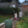 Ella sweeps up the leaves