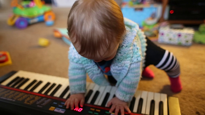 """Ellie finds the """"demo"""" button on an old keyboard."""