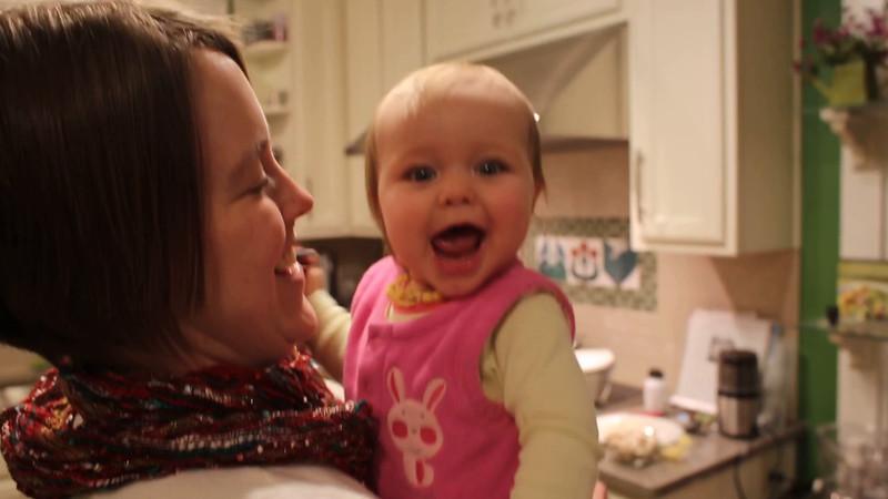 tired Ellie headbutts Mom.