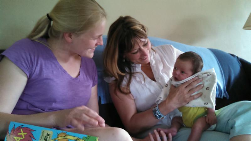 Aunts Senta and Sally help Ellie burp.