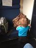 Eloise exploring on the train