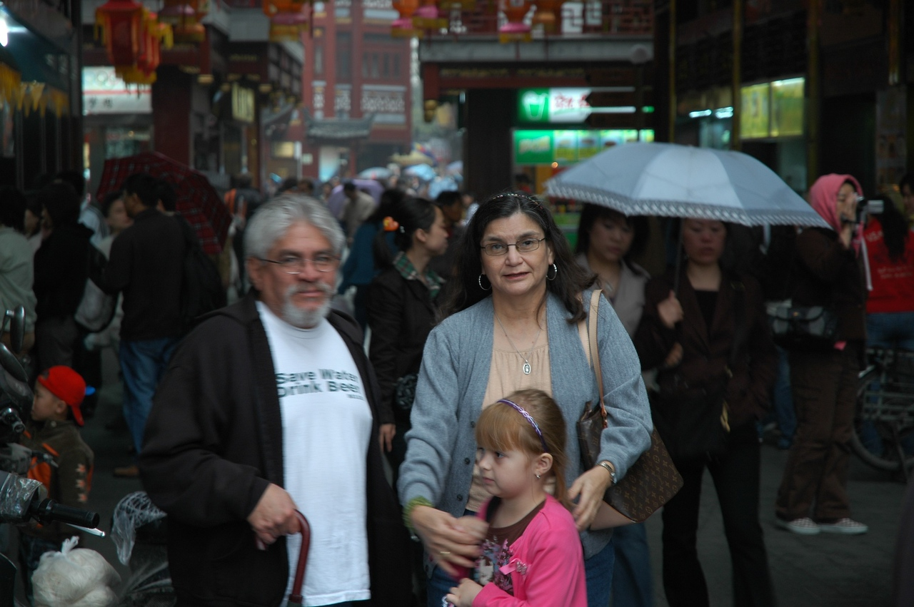 Tuesday, April 22nd - Our first day out sight seeing and today we would visit 1) Old Town 2) Yuyuan Garden 3) Pearl Tower.  Picture of Mom, Dad and Mia at one of the entrances into Old Town.  The Yuyuan Garden is in the middle of Old Town.  It was rainy that day and we needed our umbrellas!
