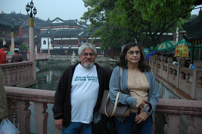 Mom and Dad on the twisting bridge past the Mid-Lake Pavilion Tea House that leads to the entrance of the Yuyuan Garden.