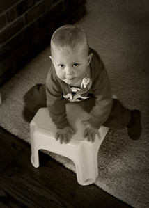 On the step stool.