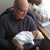 Grandpa Ian says hello to his new Granddaughter.