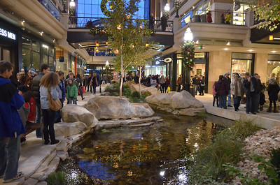 The new CityCreek mall in Salt Lake City.  Part of the mall is outdoors.  Part of the mall is covered by large glass ceilings.  The glass ceiling can be retracted during warmer weather so that the entire mall is outdoors.  There is part of an actual creek that runs through the mall.  The creek has fish in it.  It was amazing.