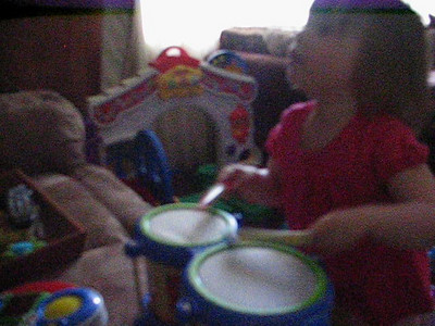 Banging 'Old MacDonald Had A Farm' on her drums. :26 seconds in is the best part!