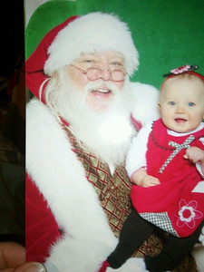 Photo of a photo of Emily with Santa. Dec. 2011, her first Christmas.  ~10 months