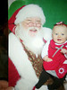 Photo of a photo of Emily with Santa.<br /> Dec. 2011, her first Christmas.  ~10 months