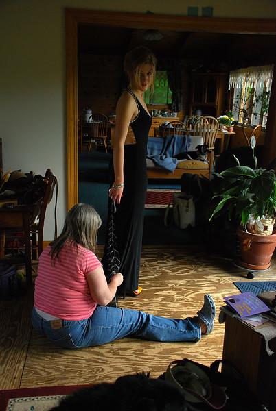 Marlene fixing Emily's shoes
