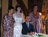 Maire Taylor, the bride's mother, Emma and James Coxon and Sue Coxon, the groom's mother posing for the photographers.