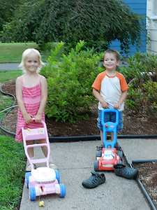 Allegra and Miller with their mowers