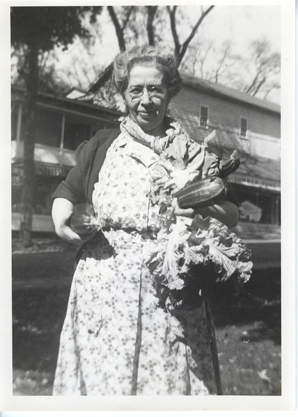 """Assunta Terni in Millerton, October 1946.  Victory Garden harvesting.  Probably somewhere around what is now Century Boulevard (notice """"Lumber"""" sign in background)."""