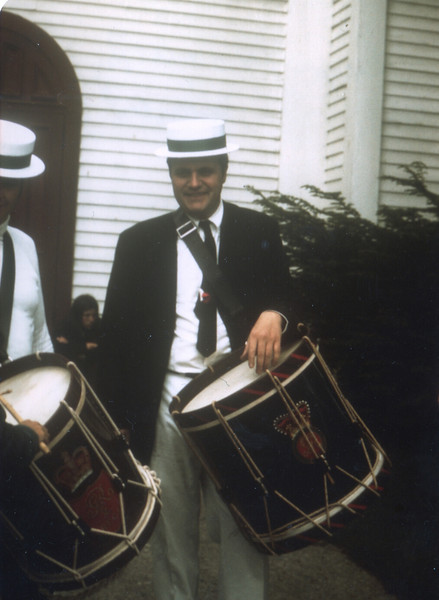 Phil Terni in full Memorial Day parade drumming mode standing in front of the Methodist church, Millerton, NY.  May 30, 1974.