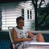Henrietta enjoys Stephanie's rocking chair on the porch at 1181 Phoenix.
