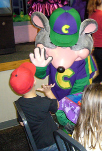 A Chuck E. Cheese high-five for the birthday boy