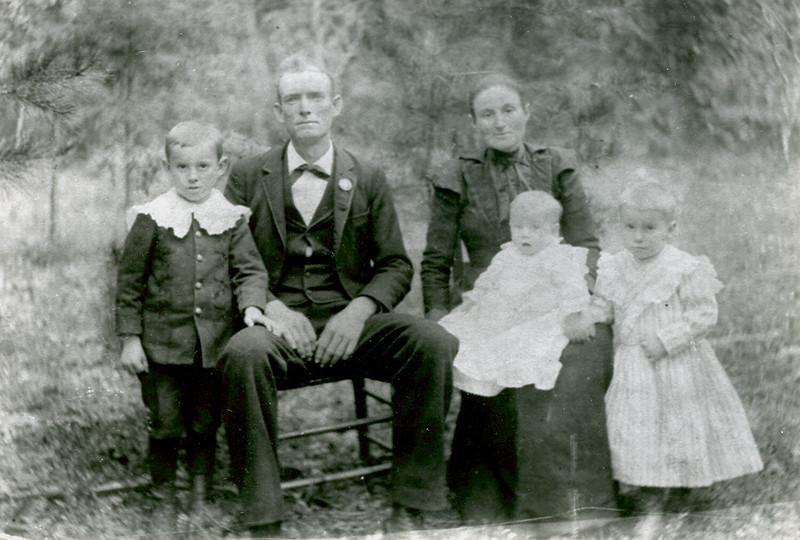 The Jesse and Charlotte Evans Holbrook Family .Owsley Co Ky.<br /> <br /> Clayton,Jesse,Charlotte holding baby Levada,Burton. Charlie was not born yet. ca. 1900<br /> <br /> Best viewed using the slideshow feature at the top right.