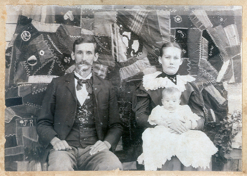 Pete and Marzenia Couch Evans with daughter Nannie. Camilia Evans made the quilt. Owsley Co Ky.