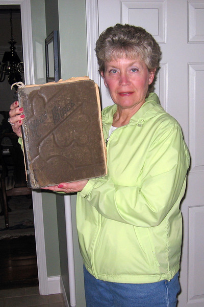 Nancy Thompson;G-G-Grand-daughter of James and Margaret Allen Evans;holding their old family Bible.