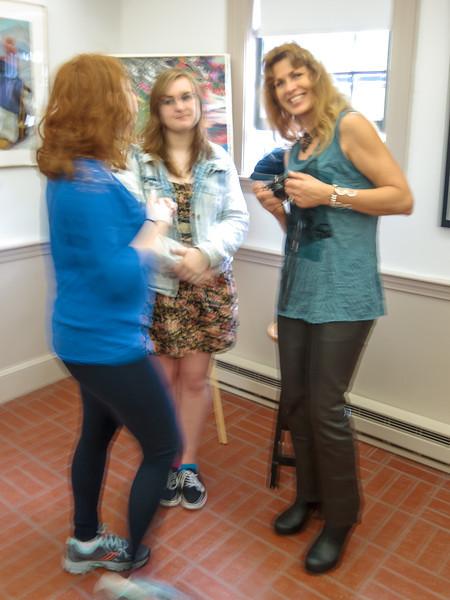 Two art students talk with Amanda Dunbar Rogers.