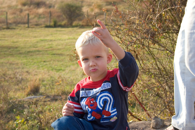 Ryan flashing his west coast gang sign.