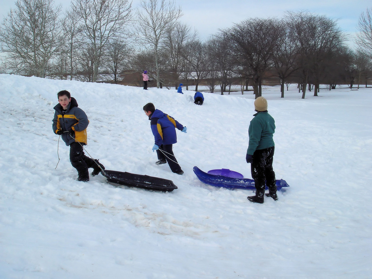 A mom directs the sled recovery operation