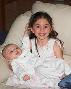"""Katie is K.C.'s """"God Sister.""""  She is especially happy to hold him."""