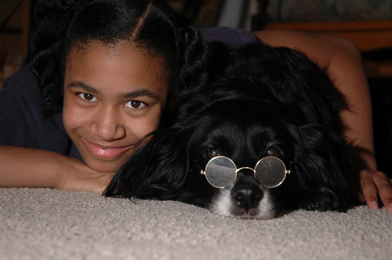 OK, I really loooove this photo.  I'm thinking about blowing it up and putting it on a wall or something.  What a couple of cuties!  Our dog, Buster, is definitely a member of the family.  The glasses belong to someone's stuffed toy.