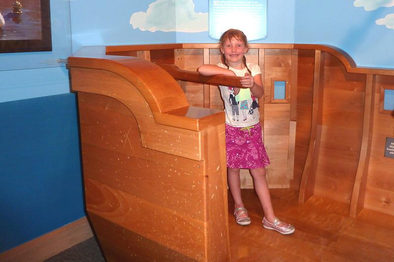 """Sophie at the tiller of """"Nephi's boat"""""""