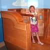 "Sophie at the tiller of ""Nephi's boat"""