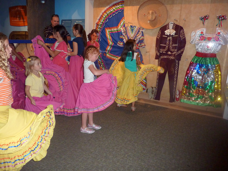 Sophie, following the instructions for a Mexican folk dance.