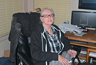 Lynn working on the computer.  Actually she just happend to sit down by it.