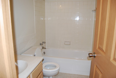 Big bathroom; tile floor and shower