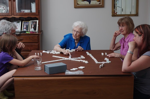 An intense game of dominos.