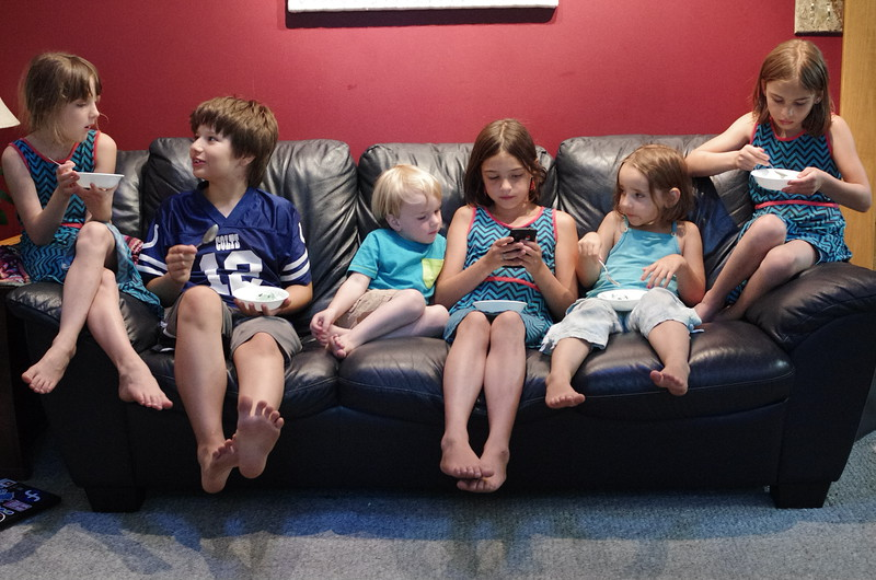 On the couch (with the Kingsley kids).