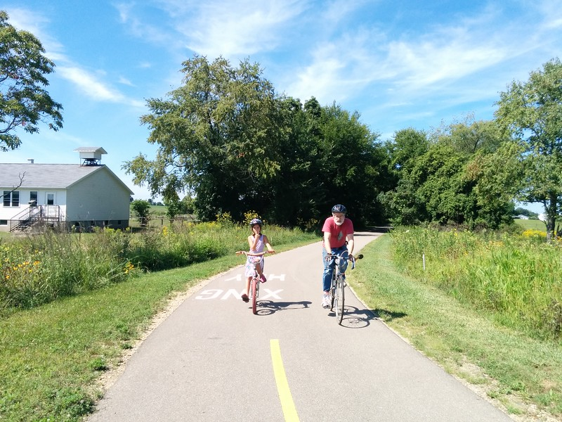 Papa and Guen on the Pumpkinvine bike trail.