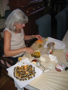 GREEN OLIVES, BABY ONIONS, CHEESE SQUARES & OYSTERS -- Betsy fixes holiday favorites.