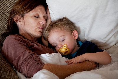 Hunter and Mom take a nap on the couch at my parent's house in Oak Forest, Illinois on November 26, 2010.  (Jay Grabiec)