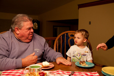 Papa Gus and my Mom feed hunter some dessert at my parent's house in Oak Forest, Illinois on November 26, 2010.  (Jay Grabiec)