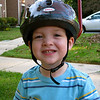 Colin with helmet on tricycle.