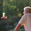Dad communing with the humming birds, up-close and personal.