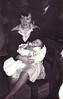 Carmen con su hijo Luis en su bautizo