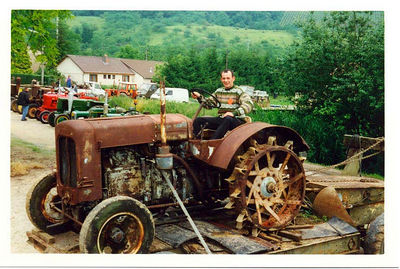 My brother Didier on one of his old tractors. One day, he is hoping to have a museum to show his 60 old tractors