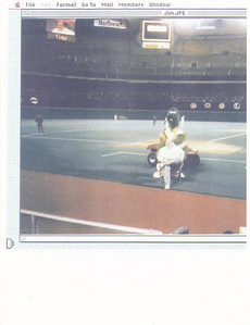 Jim on the Phillies' field with their mascot (Phillies Phanatic)--his picture is also on the TV screen
