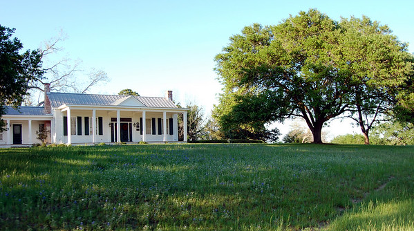 White house at the top of the hill